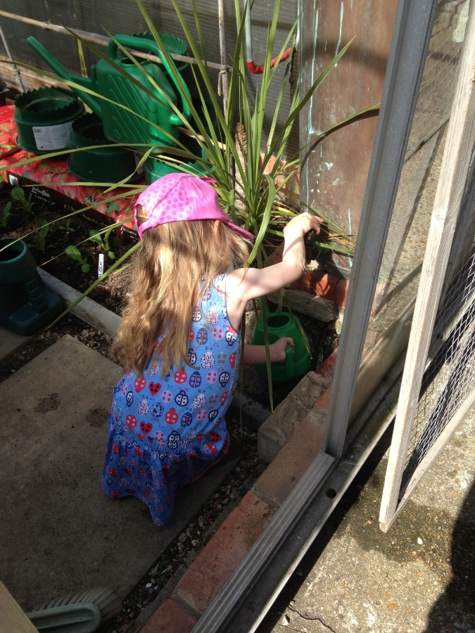 Getting water for her watering can